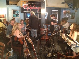 Shot from just about where I was sitting of my co-conspirator in the round this past Saturday at The Bluebird Cafe.